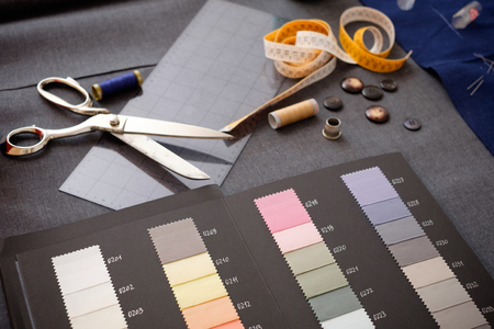 tailored: Tailor tools isolated on textile background Stock Photo