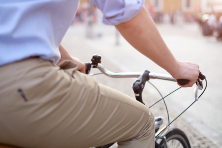 townhouses: Close-up of man on a bicycle in the city Stock Photo
