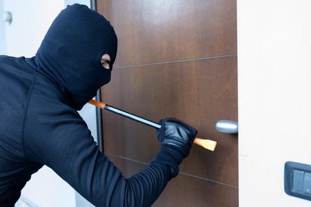 crowbar: Burglar trying to force a door lock using a crowbar