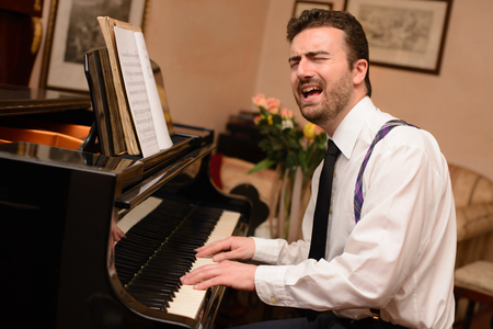 performer: Portrait of music performer playing his piano Stock Photo