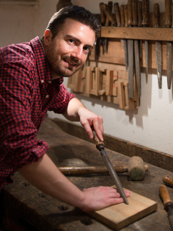 Carpenter working with tools in his carpentry Stock Photo