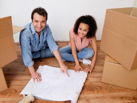 interracial couple: Young interracial couple ready for home relocation Stock Photo