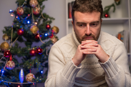 Man felling depressed and lonely during the christmas time
