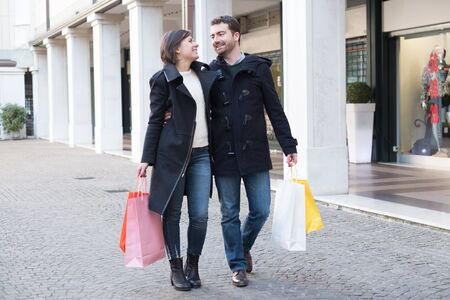COSTUMERS: Couple in shopping time walking in the city street