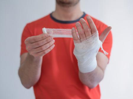 Sport man with bandages medication on his hand suffering after a sport injury Stock Photo