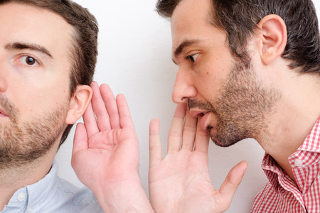 confessing: Man confessing a secret to another one in the air