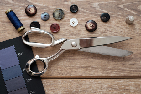 tailored: Tailor tools isolated on wooden background