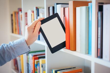 E-book reader and colorful bookshelf