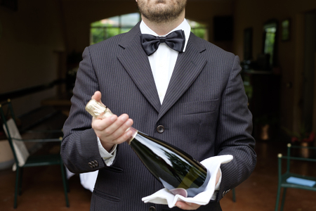 Waiter in formal dress serving champagne  Stock Photo