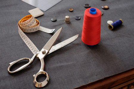 Tailor tools isolated on piece of fabric background