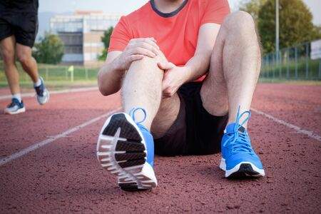 contracture: Runner with injured knee on the track