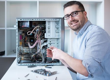 dismantle: Professional man repairing and assembling a computer desktop