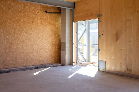 mess: Empty construction site made of wooden wall
