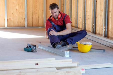 Worker suffering after  on-the-job injury Stock Photo
