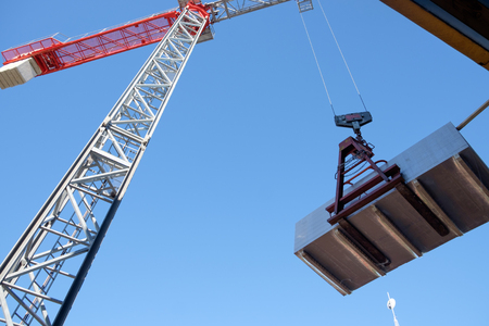 buildingsite: Building site crane under blue sky