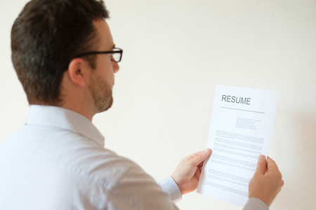 joblessness: Man with resume and work career ready to find a job Stock Photo