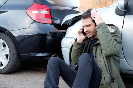 pileup: Man calling first aid after car crash accident Stock Photo