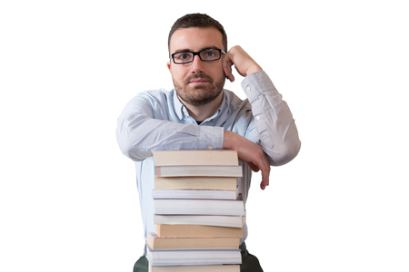 Young man and pile of books isolated on white background Stock Photo