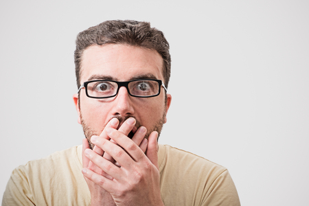 Head of surprised geek man portrait  isolated on gray background Stock Photo