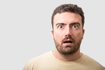 gasping: Head of surprised man portrait  isolated on gray background