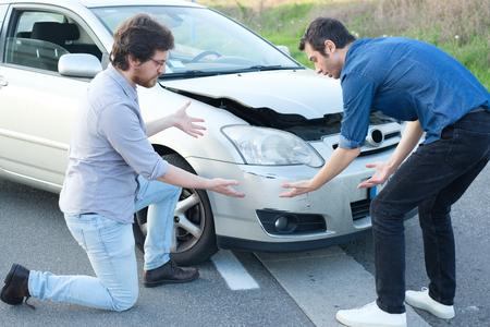 pileup: Two angry men arguing after a car fender-bender crash