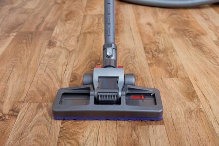Vacuum Cleaner Used On A Parquet Wooden Floor Stock Photo Picture