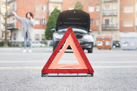Desperate woman calling for emergency help after vehicle breakdown Stock Photo
