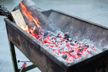 outdoor fireplace: Hot embers into the grill ready for the barbecue