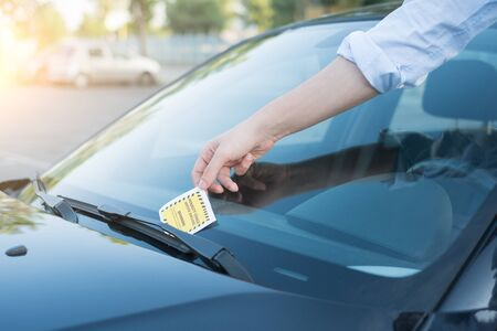 law breaker:  Ticket fine because of parking violation on the windshield