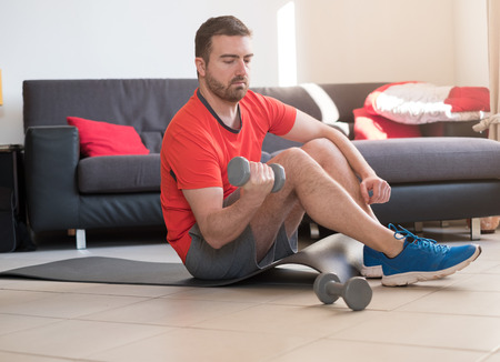 Man doing body exercise and working out at home Stock Photo