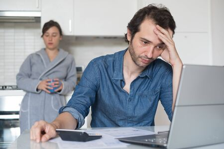 Sad family man trying to find a solution for taxes and debts Stock Photo