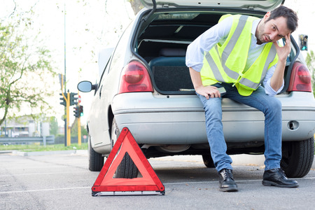 Sad and stressed man waiting after unexpected car breakdown Stock Photo