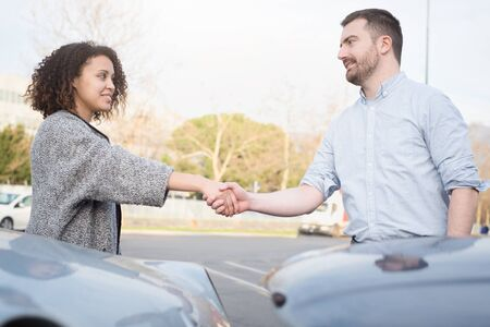 Man and woman finding an agreement after car crash