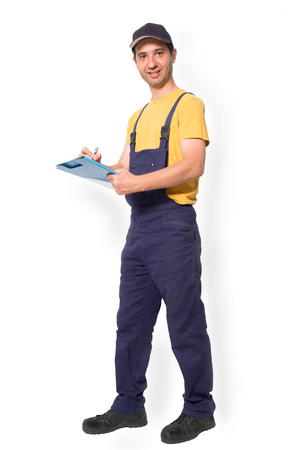 Mechanic worker standing with clipboard isolated on vertical white background
