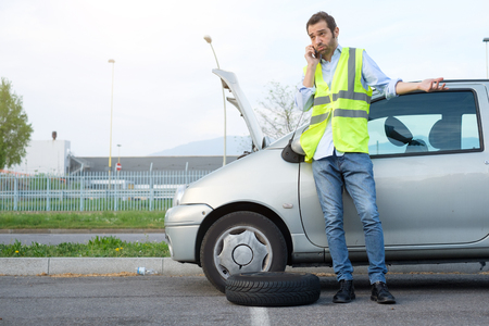 Man calling mechanic help service after car engine breakdown photo