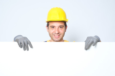 Worker holding a copy space cardboard for text advertisement photo