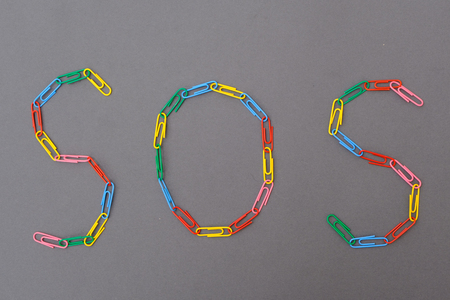 Sos word made of paper clips isolated Stock Photo