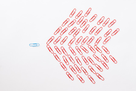 mobbing: Metaphor of one against many made of colorful paperclips