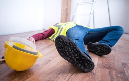 On the job injury of one worker fallen from a ladder Zdjęcie Seryjne - 85831199