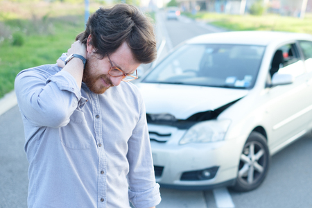 Man feeling pain to the neck after a car crash Zdjęcie Seryjne - 85831200