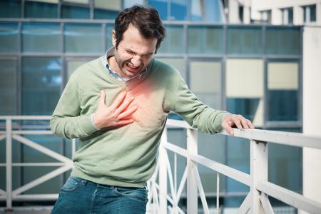 Man having  a sudden heart attack  and feeling bad Stock Photo