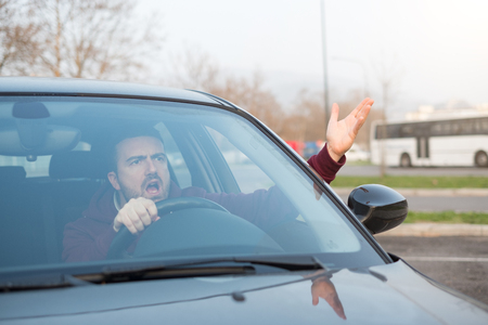 Rude man driving his car and arguing a lot Stock Photo