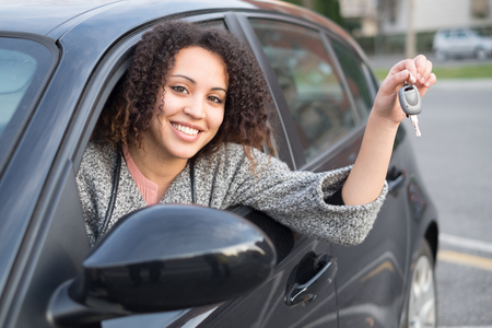 Girl very happy after purchasing a new car Stock Photo