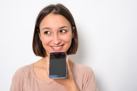 Young woman using phone vocal assistant and sending vocal message