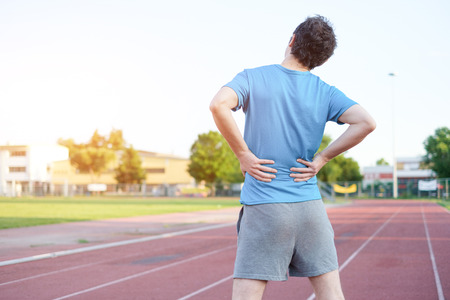 Sportsman feeling backache because of herniated disc Stock Photo
