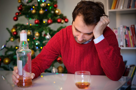 Lonely man celebrating christmas and get dunk alone