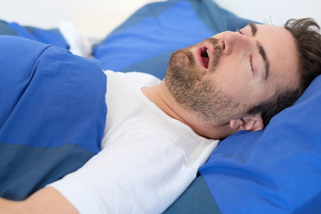 Face close up of snoring man because of hypopnea disorder Stock Photo
