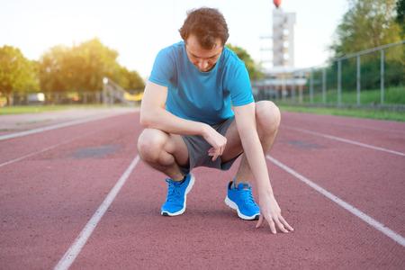Running sportsman feeling pain after having an injury Stock Photo