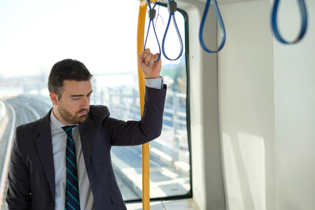 Businessman commuter is traveling and he is sad and tired Stock Photo