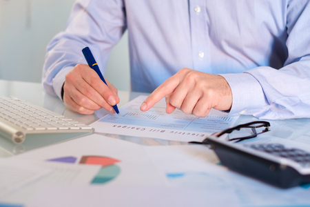 Hand man doing finances and accounting about cost at home office.Concept finances and economy Stockfoto